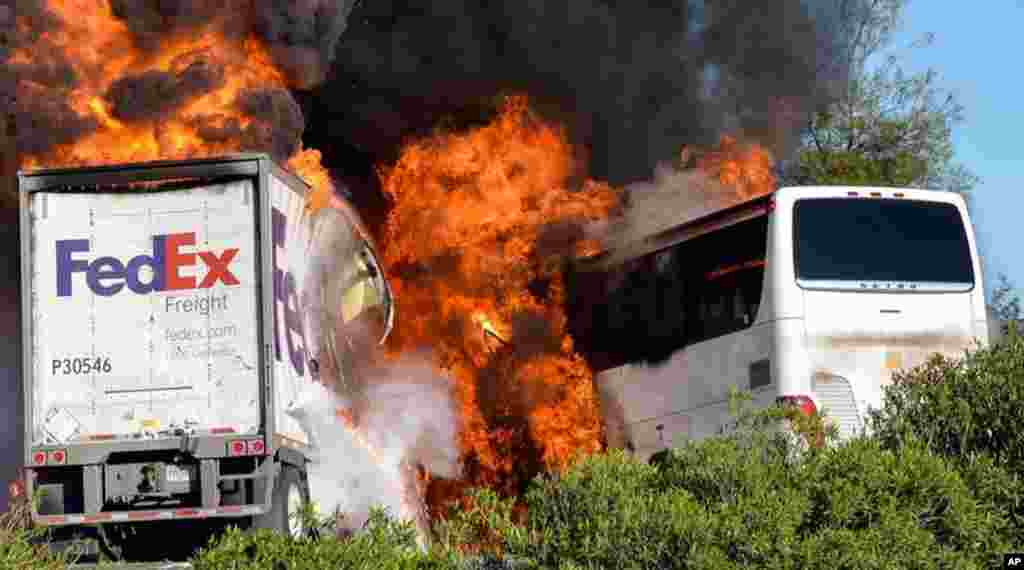 Massive flames are seen devouring both vehicles just after the crash, and clouds of smoke billowed into the sky April 10, 2014 until firefighters had quenched the fire, leaving behind scorched black hulks of metal. The FedEx tractor-trailer crossed a grassy freeway median in Northern California and slammed into the bus carrying high school students on a visit to a college. At least 10 were killed in the fiery crash.