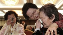North Korean Kim Tae Un weeps in the meeting with her South Korean sister Kim Sa-bun.