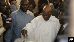 President Abdoulaye Wade casts his ballot for president at a polling station in Dakar, Senegal, Sunday, March 25, 2012.