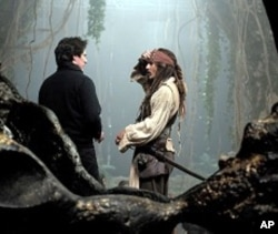 Director Rob Marshall on the set of the movie with Johnny Depp