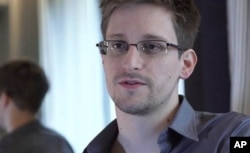 FILE - Edward Snowden, who worked as a contract employee at the National Security Agency, speaks to The Guardian newspaper in Hong Kong, June 9, 2013.