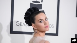 Katy Perry arrives at the 56th annual Grammy Awards at the Staples Center, Jan. 26, 2014, in Los Angeles.