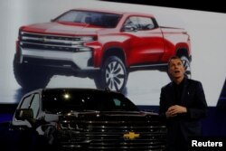 FILE - General Motors Global Design chief Michael Simcoe helps unveil new Chevy Silverado trucks at the North American International Auto Show in Detroit, Michigan, Jan. 13, 2018.