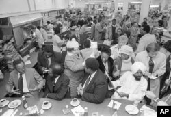 Former North Carolina A & T students, left to right, Joseph McNeill, David Richmond, Franklin McCain and Jibreel Khazan, are shown at the F.W. Woolworth lunch counter in Greensboro, N.C., Feb. 1, 1980.