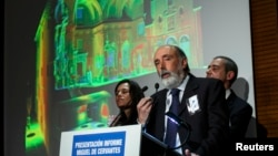 Forensic archaeologist Francisco Etxeberria, center, historian Francisco Marin, right, and forensic anthropologist Almudena Garcia speak about the search of the remains of Spanish writer Miguel de Cervantes in Madrid March 17, 2015.