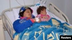 Chính phũ Syria nói bà mẹ và đứa con bị thương vì vụ tấn công bằng võ khí hóa học