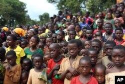 FILE - Burundian refugees attend a rally addressed by Tanzania Prime Minister Kassim Majaliwa, at Nduta refugee camp in Kigoma, Tanzania, Dec. 29 2015.