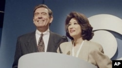 "Dan Rather and Connie Chung share the podium at a news conference in New York, May 17, 1993 where it was announced Chung will join Rather as co-anchor of the ""CBS Evening News."""