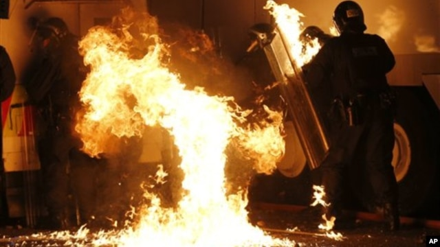 Petrol bomb hits riot police after being thrown by loyalist rioters in north Belfast, Northern Ireland, July 13, 2013.