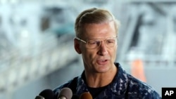 FILE - In this June 18, 2017, file photo, U.S. Navy Vice Adm. Joseph Aucoin, Commander of the U.S. 7th Fleet, speaks during a press conference, with damaged USS Fitzgerald as background at the U.S. Naval base in Yokosuka, southwest of Tokyo. U.S. official