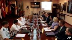 FILE - Philippine and U.S. negotiators discussing U.S. troop presence in the Philippines are seen meeting at the Department of National Defense headquarters in Quezon city, north of Manila.