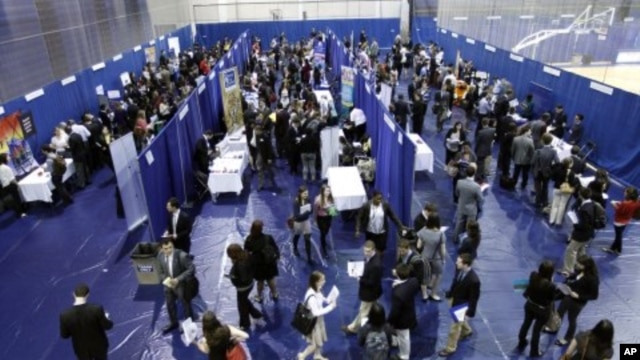 Students walk among recruiting booths during a career job fair at American University in Washington, March 28, 2012.