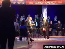 President Barack Obama, left, speaks during a CNN televised town hall meeting hosted by Anderson Cooper, right, at George Mason University in Fairfax, Va., Jan. 7, 2016.
