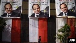 Des affiches de Sissi, dans le quartier de Giza, au Caire, le 25 mars 2018.