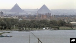 A traditional felucca sailing boat transits the Nile river passing the Pyramids of Giza in Cairo, Egypt. (file photo)