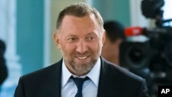 FILE - Russian metals magnate Oleg Deripaska attends a meeting in the Konstantin palace outside St. Petersburg, Russia, Aug. 9, 2016.