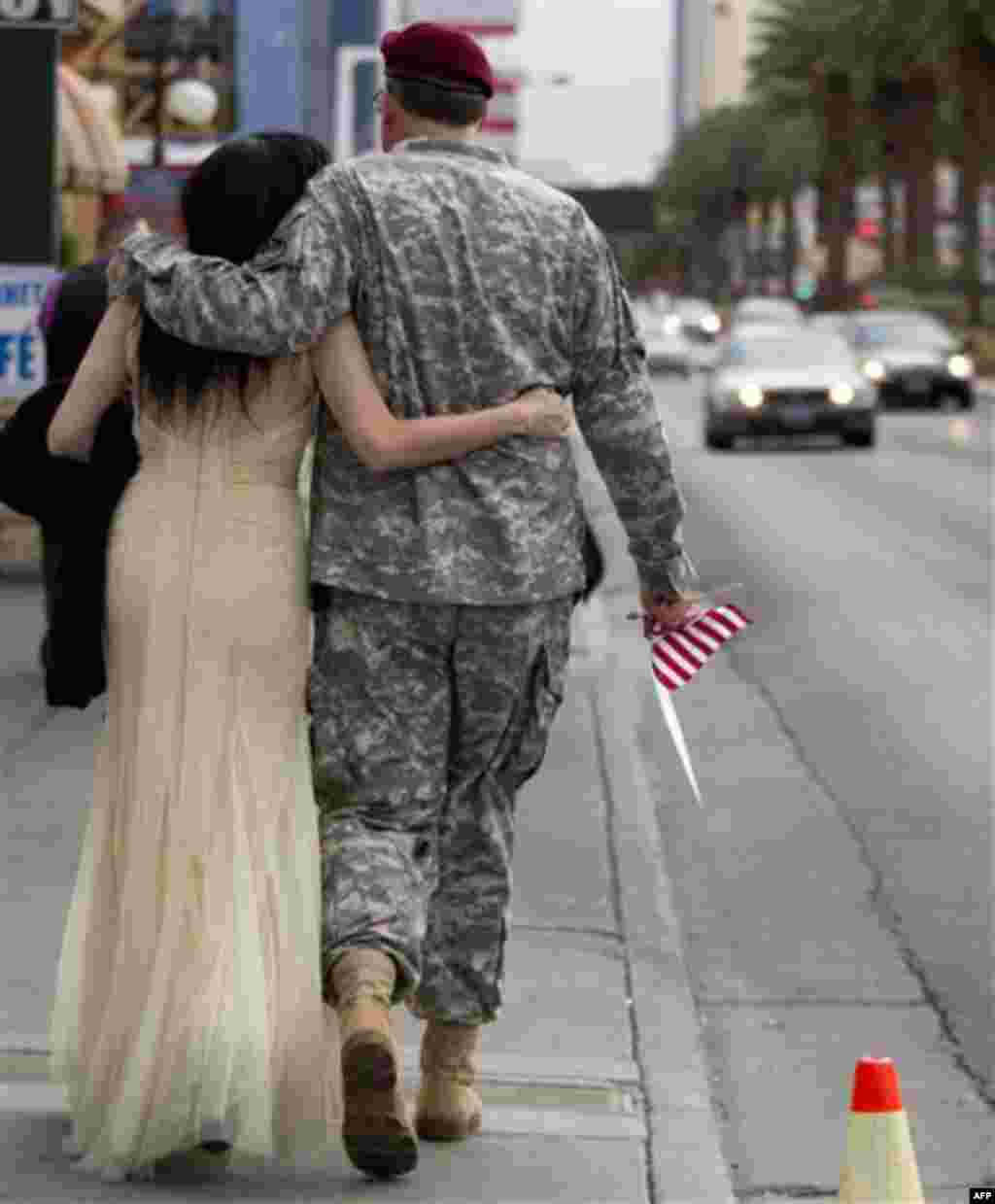 U.S. Army Master Sgt. Robert McLaughlin, right, of Suffolk, Va., and Karen Gold of Edinburgh, Scotland, walk down Las Vegas Boulevard after getting married at A Little White Chapel wedding chapel, Friday, Nov. 11, 2011, in Las Vegas. McLaughling, who join