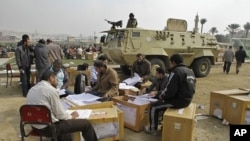 Election officials count ballots for the parliamentary elections in Cairo, Egypt, November 30, 2011.