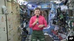 In this April 13, 2017, image from video made available by NASA, astronaut Peggy Whitson speaks during an interview aboard the International Space Station.