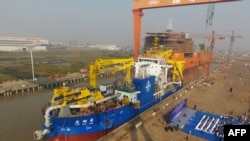 This photo taken on Nov. 3, 2017 shows the ship 'Tian Kun Hao' being launched at a port in Qidong in China's eastern Jiangsu province.