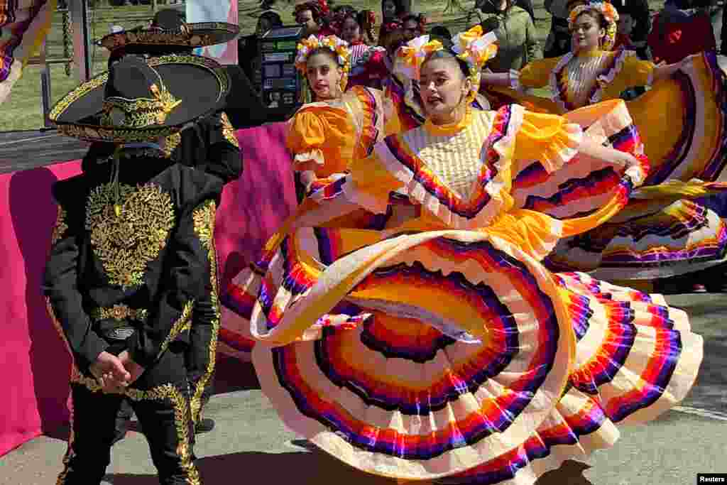 A dance troupe performs traditional Mexican dances at the 2018 National Cherry Blossom Festival near the Tidal Basin in Washington, D.C., March 18, 2018.