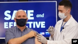 Vice President Mike Pence receives a Pfizer-BioNTech COVID-19 vaccine shot at the Eisenhower Executive Office Building on the White House complex, Friday, Dec. 18, 2020, in Washington. Karen Pence, and U.S. Surgeon General Jerome Adams also participated.