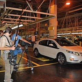 Filmmaker Chris Paine's crew films the General Motors Chevy Volt production line.