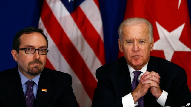 U.S. Vice President Joe Biden, right, accompanied by the U.S. Ambassador to Turkey John R. Bass, talks during a meeting with Turkish civil society groups on first day of his visit to Turkey, in Istanbul, Jan. 22, 2016.