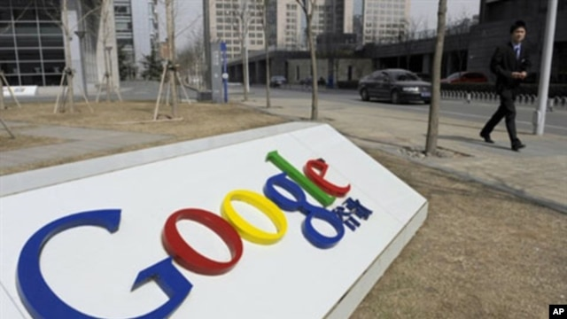 A man walks past the Google company logo outside the Google China headquarters in Beijing (file)