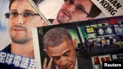 Photos of Edward Snowden, a contractor at the National Security Agency (NSA), and U.S. President Barack Obama are printed on the front pages of local English and Chinese newspapers in Hong Kong, June 11, 2013.