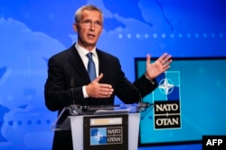 FILE - NATO Secretary-General Jens Stoltenberg speaks at the NATO headquarters in Brussels on August 20, 2021.