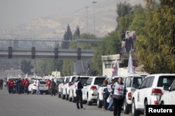A convoy consisting of Red Cross, Red Crescent and United Nation gather before heading towards Madaya from Damascus, and to al Foua and Kefraya in Idlib province, Syria, Jan. 11, 2016.