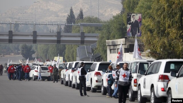 A convoy consisting of Red Cross, Red Crescent and United Nation (UN) gather before heading towards to Madaya from Damascus, and to al Foua and Kefraya in Idlib province, Syria, Jan. 11, 2016.