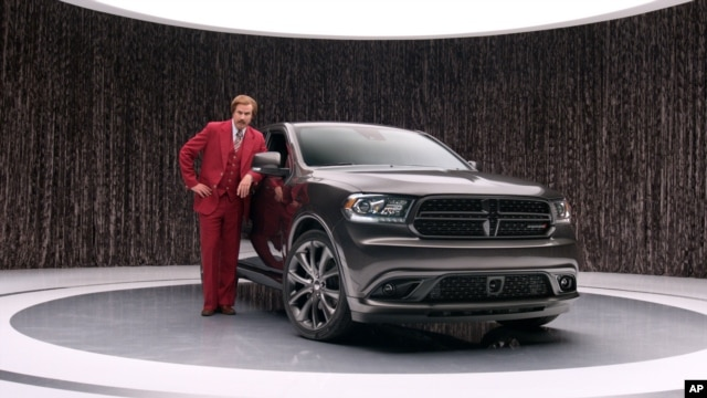 This undated photo provided by Chrysler shows Will Ferrell as 'Anchorman' character Ron Burgundy in an advertisement for the 2014 Dodge Durango.