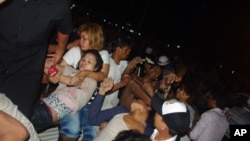 Stampede victims are seen rescued by police officers and fellow bystanders. The Diamond Bridge tragedy killed 353 people and injured nearly 400.