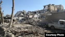 Wilayah Alun-alun Al-Salam di Kobane yang porak-poranda setelah terjadi serangan yang dilancarkan ISIS dengan menggunakan truk yang membawa bahan peledak, 22/10/2014.
