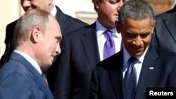 图为美国总统奥巴马(右)与俄罗斯总统普金(左)(资料照片)
