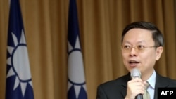 Wang Yu-chi, minister of Taiwan's Mainland Affairs Council, speaks during a press conference in Taipei, Jan. 28, 2014.