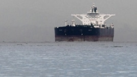 "Malta-flagged Iranian crude oil supertanker ""Delvar"" is seen anchored off Singapore on March 1, 2012. Western trade sanctions against Iran are strangling its oil exports even before they go into effect."