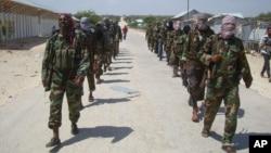 FILE - Members of Somalia's al-Shabab militant group patrol on the outskirts of Mogadishu, Somalia, March 5, 2012.