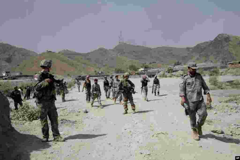 U.S. forces patrol near the scene of an attack by militants on a U.S. base in Torkham, Afghanistan, Sept. 2, 2013.