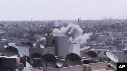 19일 시리아 정부군과 반군간 충돌이 계속되는 홈스 시.