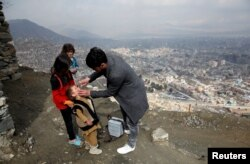 FILE - A boy receives polio vaccination drops during an anti-polio campaign in Kabul, Afghanistan, March 14, 2018.