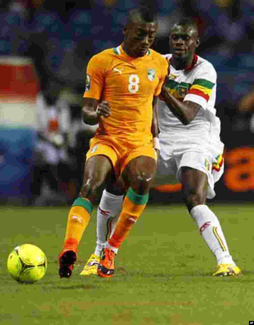 Ivory Coast's Salomon Kalou (8) plays against Mali's Mustapha Yatabare during their African Nations Cup semi-final soccer match at the Stade De L'Amitie Stadium in Gabon's capital Libreville February 8, 2012.
