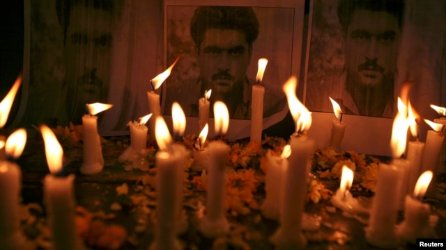 Candles are placed in front of the posters of Sarabjit Singh, who was convicted of spying for India and sentenced to death in Pakistan, during a candle light vigil to pay tribute in the northern Indian city of Amritsar, May 2, 2013.
