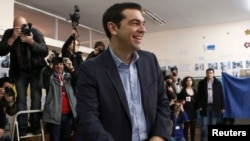 Opposition leader and head of radical leftist Syriza party Alexis Tsipras smiles before casting his ballot at a polling station in Athens, Greece, Jan. 25, 2015.