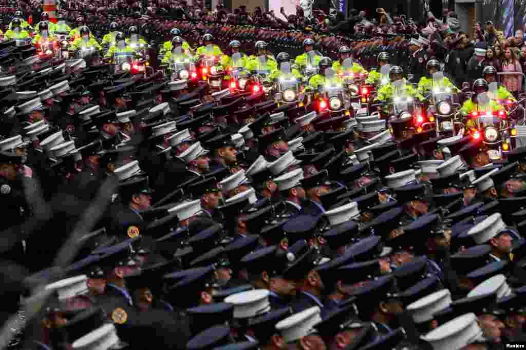 New York City Department (FDNY) officers attend a funeral service of FDNY firefighter and U.S. Marine Christopher Slutman, in New York City, U.S.