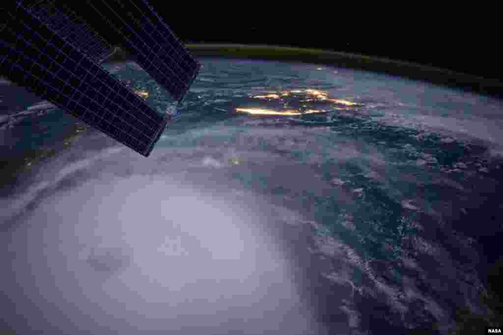 Hurricane Joaquin is seen over the Bahamas in a photo taken by astronaut Scott Kelly from the International Space Station. The Category 4 storm pounded the Bahamas for a second day with powerful winds and waves on Friday, but it was not expected to be a major threat to the U.S. East Coast.