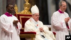 Pope Francis celebrates Mass in St. Peter's Basilica at the Vatican, Jan. 1, 2014.