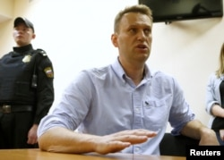 Russian opposition leader Alexei Navalny talks to journalists during a hearing at a court in Moscow, Russia, June 12, 2017.